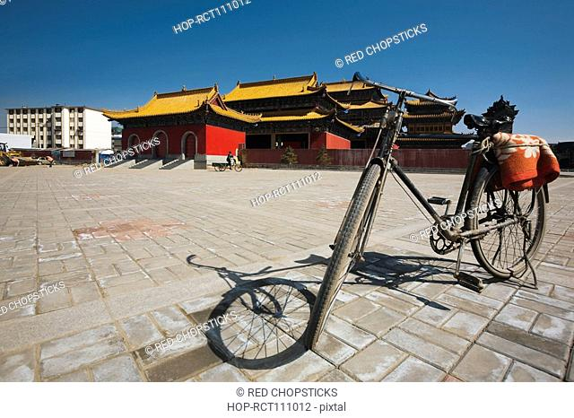 Bicycle in front of a temple, Guan Yin Si, Hohhot, Inner Mongolia, China
