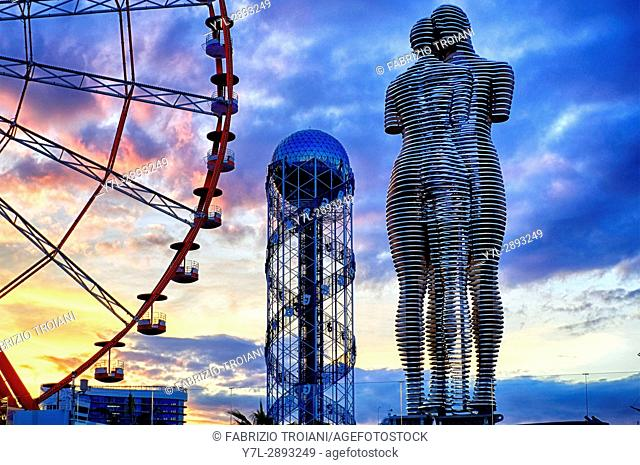 Ali and Nino sculpture, Batumi ferris wheel and the alphabet tower in Miracle Park, Batumi, Georgia