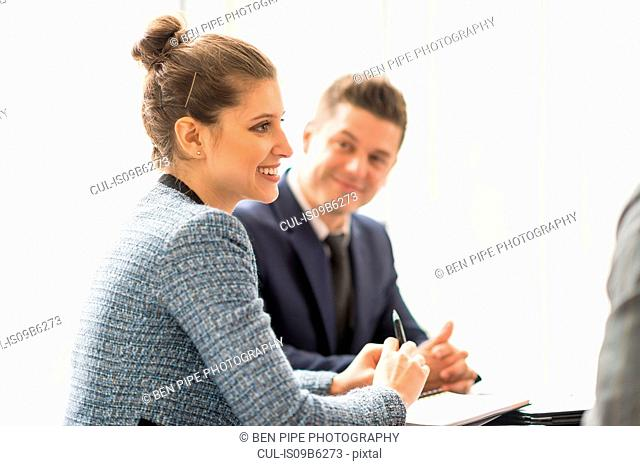 Businesswoman and man in office meeting