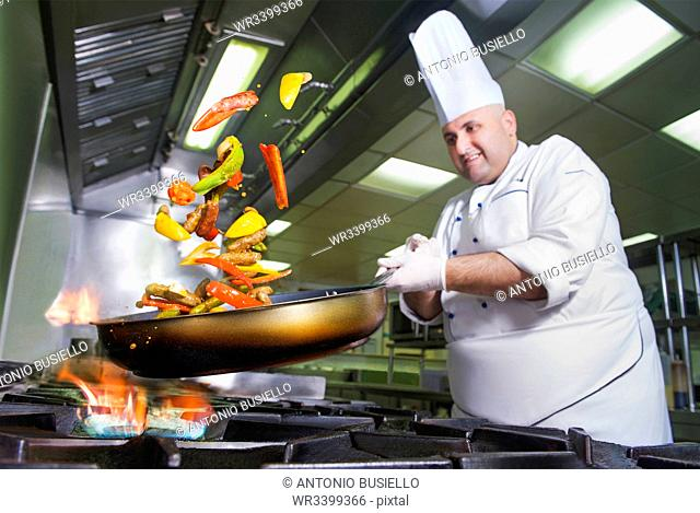 Chef cooking, Italy, Europe