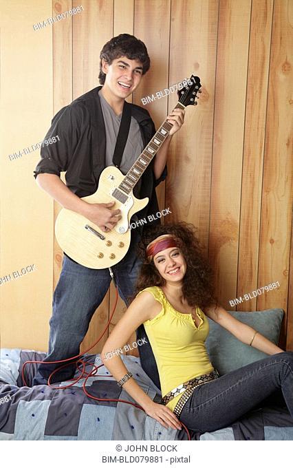 Boyfriend playing electric guitar for girlfriend