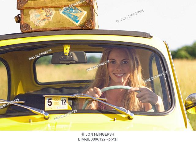 Caucasian woman driving car on road trip
