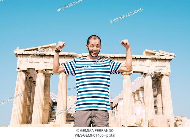 Greece, Athens, happy man visiting the Parthenon temple on the Acropolis