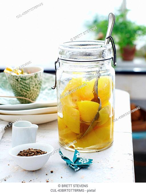 Jar of preserved fruit on table