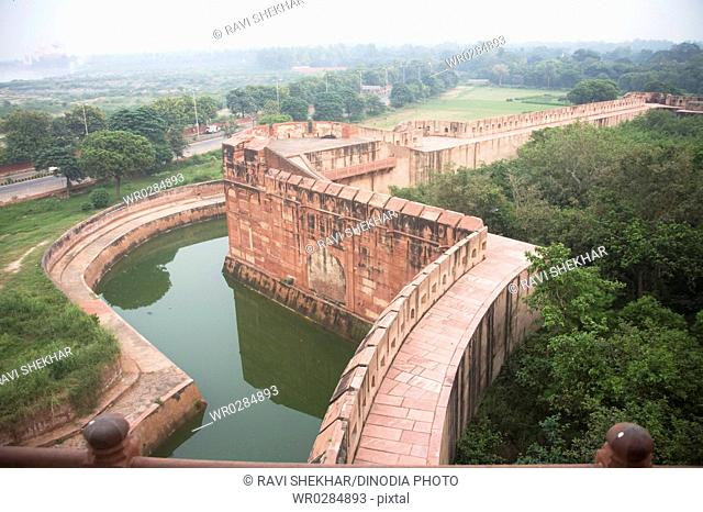Sand stone wall and water canal for safety of Agra Fort , Agra , Uttar Pradesh , India