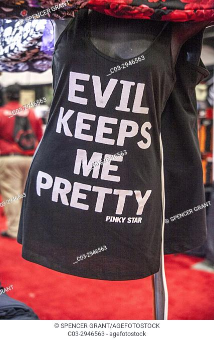 A woman's tank top with an amusing and slightly naughty message is for sale at a tattoo convention in Costa Mesa, CA