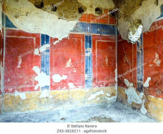 Room decorated in the fourth style with red panels on a dark blue ground above a lower red frieze. The panels feature small cameos of soldiers in different...