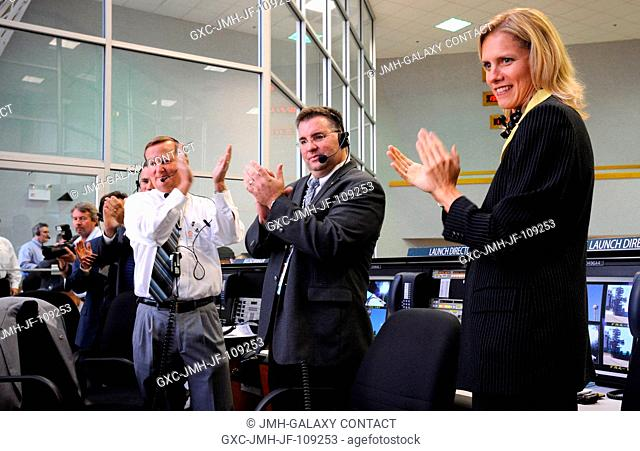 NASA Shuttle Launch Director Michael Leinbach (left), STS-124 Assistant Launch Director Ed Mango (center), and Flow Director for Space Shuttle Discovery...
