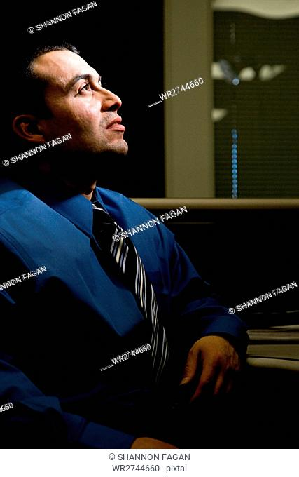 Man in dark office
