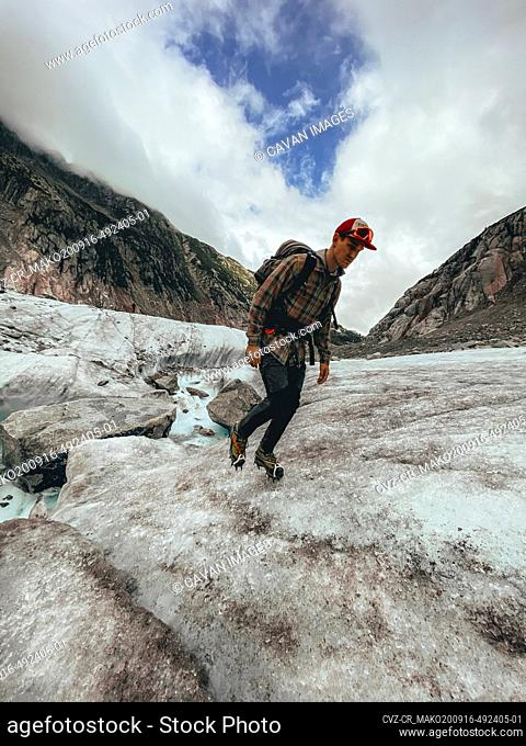 Low angle shot of climber ascending over glacier in Chamonix