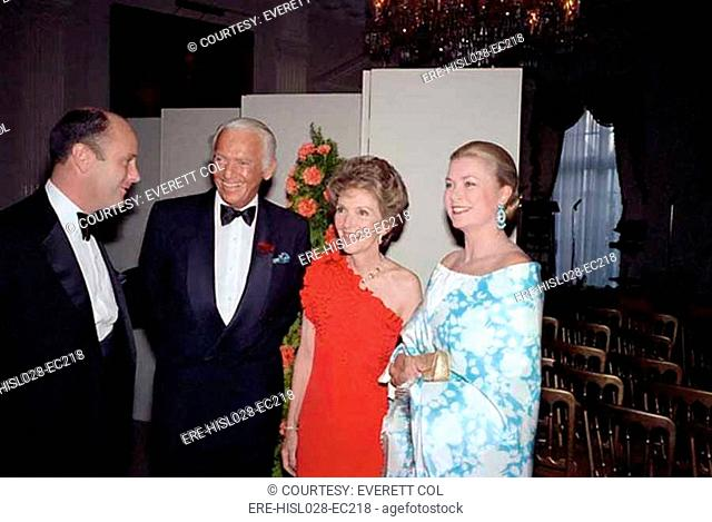 Nancy Reagan posing with Douglas Fairbanks Jr. and Grace Kelly Peter McCoy at far left during a dinner at Winfield House the US ambassador's London residence