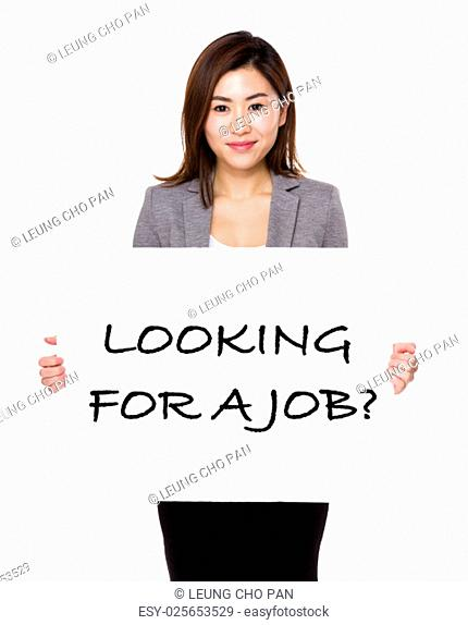 Confident businesswoman showing a poster showing with looking for a job phrases