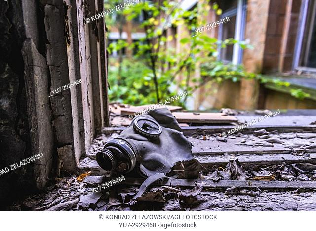 Old gas mask in High school No 3 in Pripyat ghost city of Chernobyl Nuclear Power Plant Zone of Alienation around nuclear reactor disaster in Ukraine