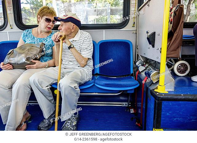 Florida Miami Beach Dade Metrobus Public Transportation South Local Pengers Riders Sitting Man Woman Senior Elderly Cane A