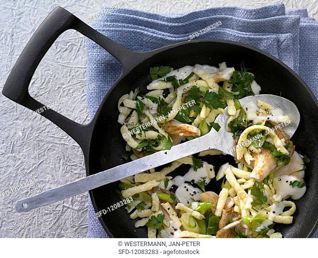 Pan-fried spätzle (soft egg noodles) with oyster mushrooms