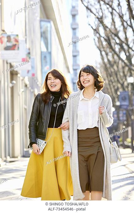 Japanese women window shopping downtown Tokyo