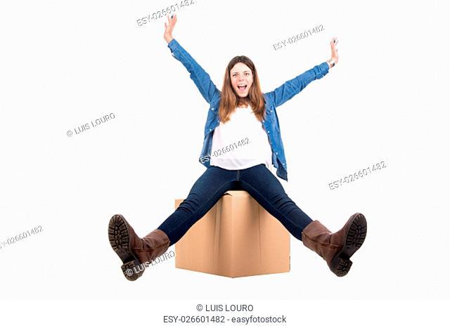 Beautiful girl with cardboard box unpacking in new home