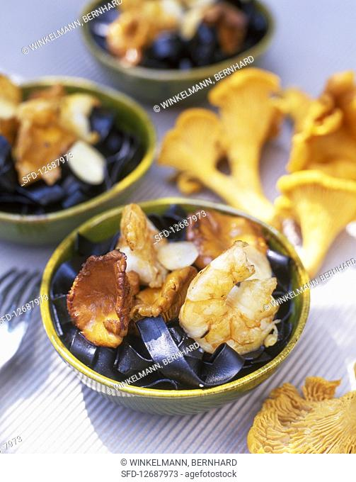 Black tagliatelle with prawns and chanterelle mushrooms