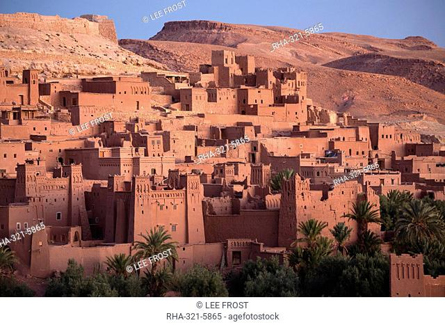 The ancient mud brick buildings of Kasbah Ait Benhaddou bathed in golden morning light, UNESCO World Heritage Site, near Ouarzazate, Morocco, North Africa