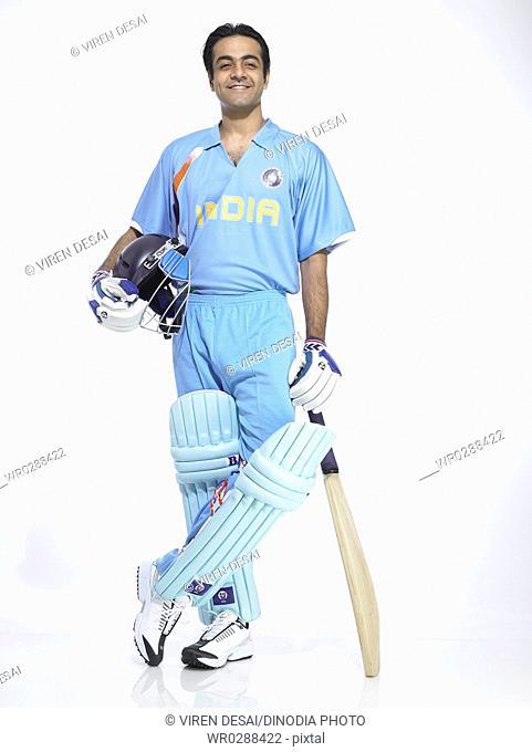 Indian batsman holding bat and helmet ready for cricket match MR702A