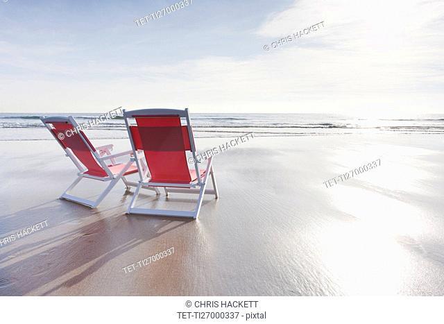 Maine, Red deckchairs on empty beach