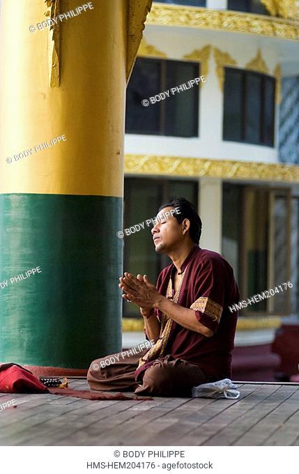 Myanmar Burma, Rangoon Division, Rangoon city, men praying within the Paya Shewdagon Pagoda