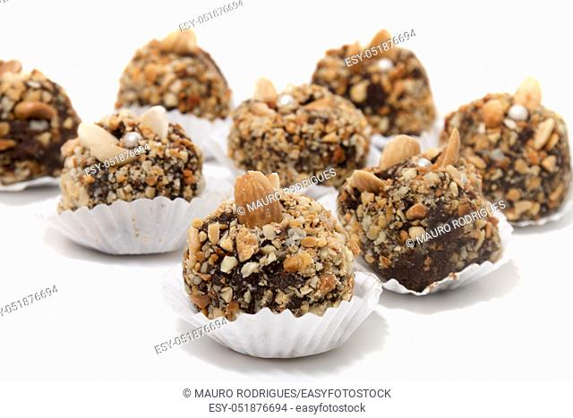 Traditional portuguese sweet of fig, carob and almond balls isolated on a white background