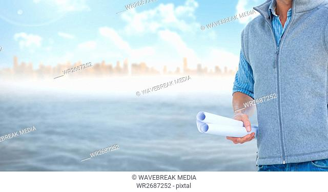 Architect Torso holding plan against sea and city background