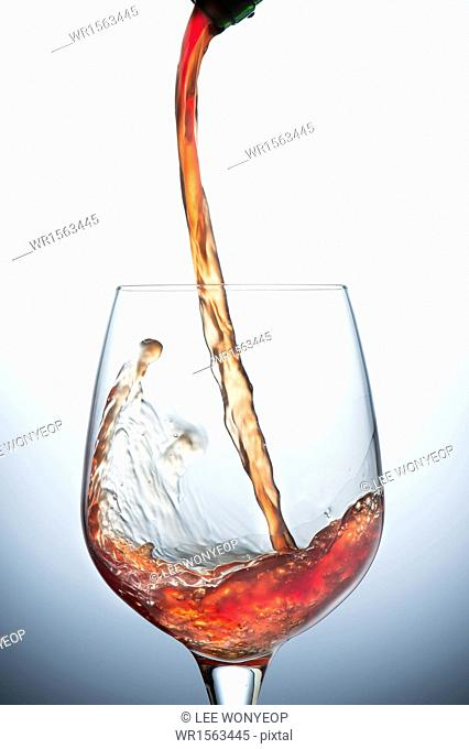 liquid being poured into a glass