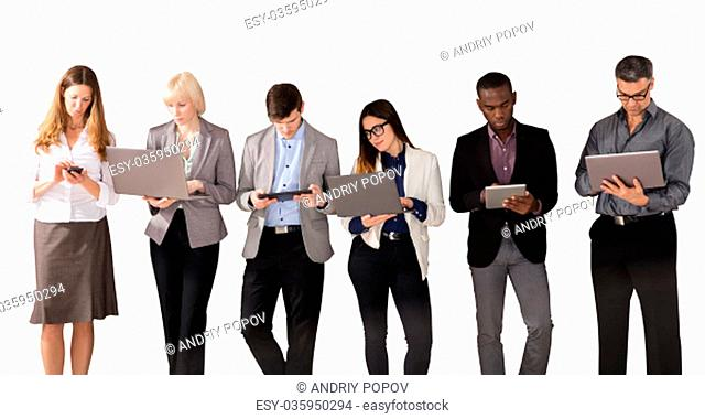 Group Of Multi Ethnic Business People Using Electronic Devices Against White Background