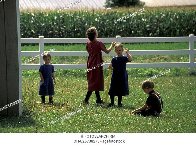 baseball, softball, Lancaster County, Pennsylvania, Pennsylvania Dutch Country, Amish children/kids playing baseball/softball in Lancaster County in the state...
