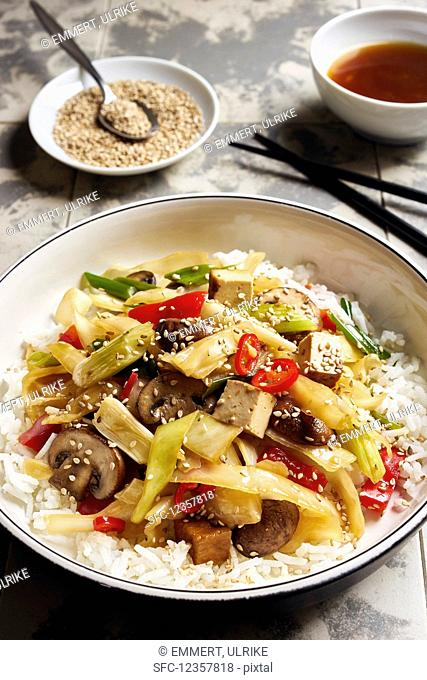 Asian style white cabbage with tofu, chili, peppers, mushrooms and sesame seeds