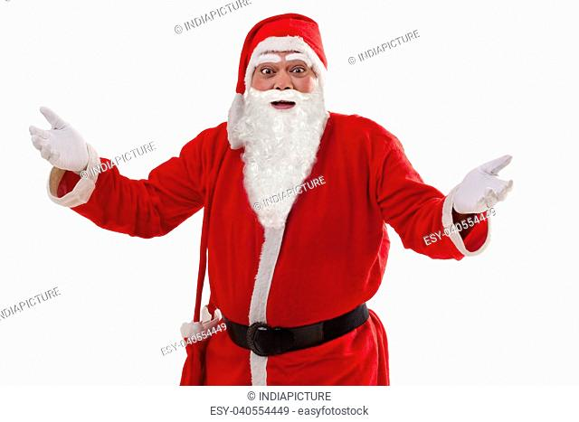 Portrait of Santa Claus with arms outstretched over white background