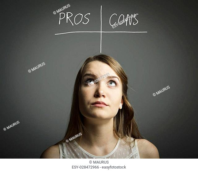 Girl in white is thinking. Pros and cons concept