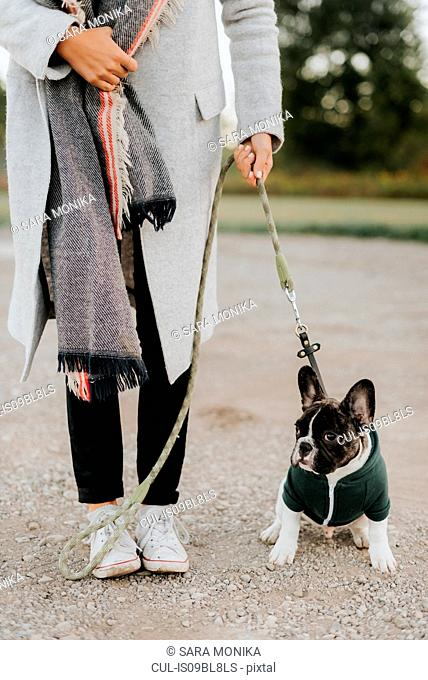 Woman with puppy on lead