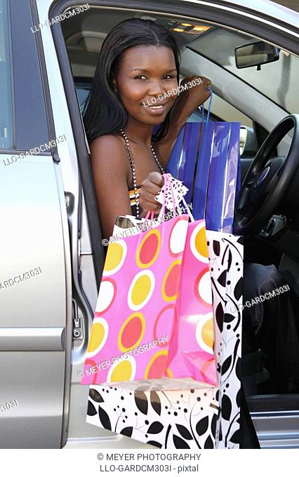 Woman in car with shopping bags, Johannesburg, South Africa