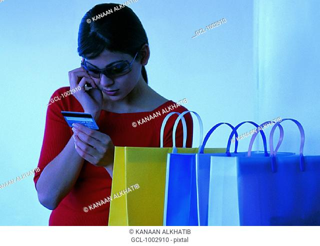 Woman checking her credit card limits during shopping