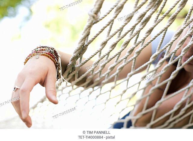USA, Utah, close up of woman's hand on hammock