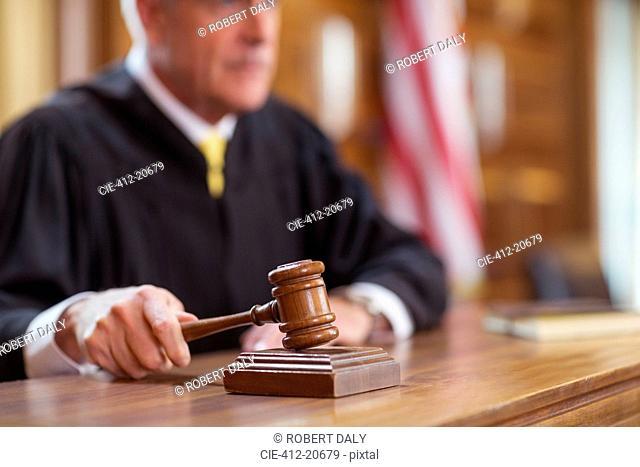Judge banging gavel in court