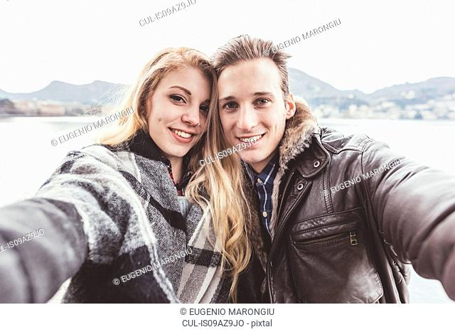 Portrait of young couple taking selfie, Lake Como, Italy