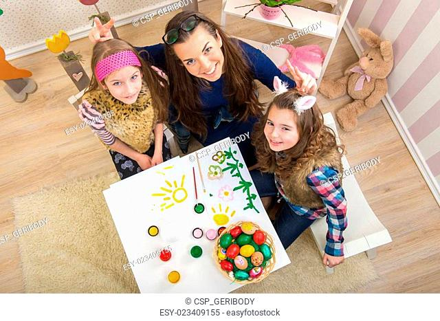 Easter - Mother and two daughters in preparation for Easter