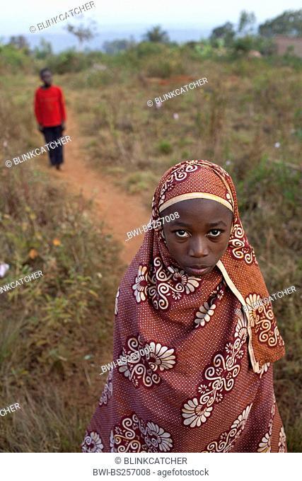 young girl in traditional african clothing on a path, Burundi, Karuzi, Buhiga