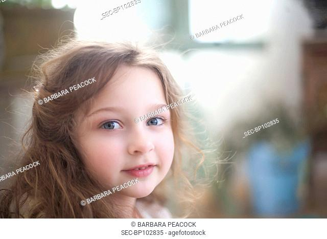 Portrait of cute girl (4-5) looking at camera