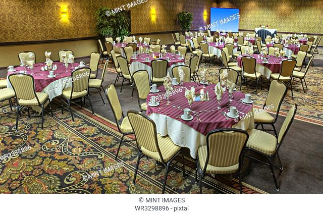 Tables in empty banquet room