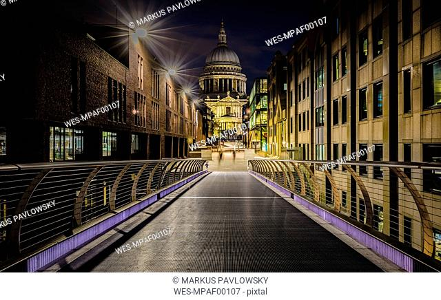 UK, London, view from Millennium Bridge to illuminated St Pauls Cathedral