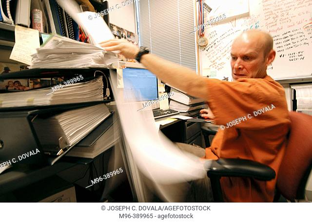 Man overwhelmed at office in motion