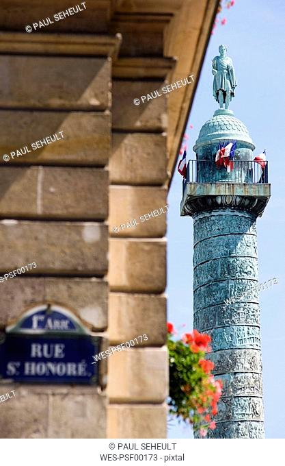 France, Paris, Place Vendome, Napoleon monument, Road sign in foreground