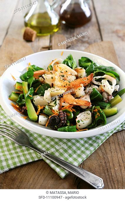 Warm seafood salad with courgettes, lambs lettuce, prawns, squid and octopus