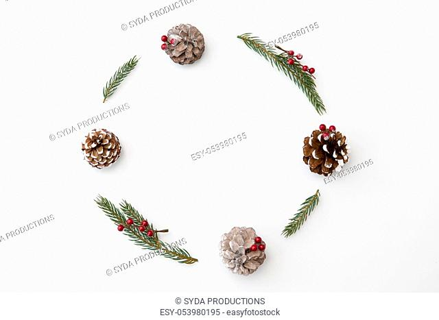 christmas frame of fir branches with pine cones