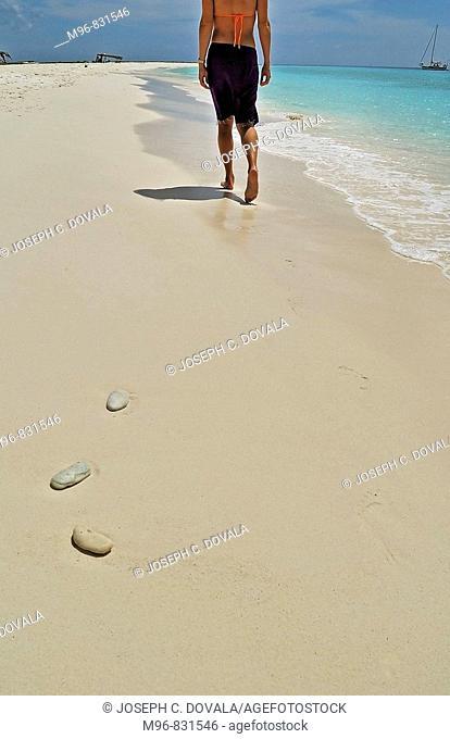 Woman walking along sandy beach, Klein Curaçao, Netherland Antilles, Caribbean